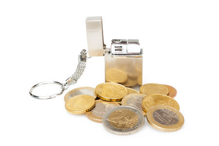 burning money: Small cigarette lighter with euro coins isolated on white