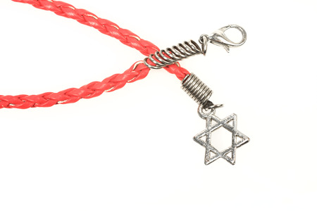 Leather bracelet with a silver Star of David isolated on white background photo