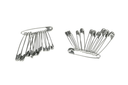 Pair groups of safety pins isolated on white background photo