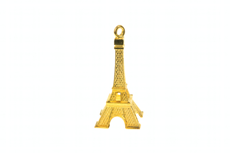 Small golden model of Eiffel tower isolated on white background photo