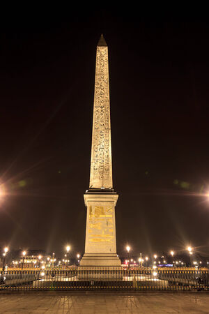 Egyptian Obelisk at the Place de la Concorde  at midnight in Paris photo