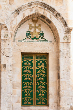 Green door in courtyard Holy Sepulcher, Jerusalem photo