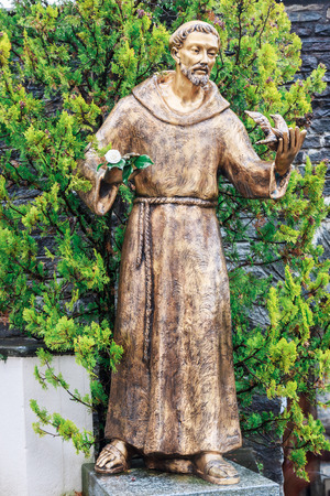 friar: Statue of monk in church courtyard Stock Photo