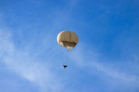 Military balloon on a blue sky photo