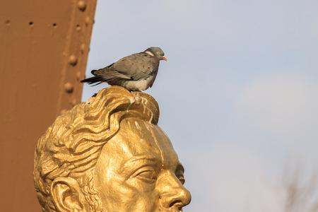 Bust Gustave Eiffel with dove near Eiffel tower photo