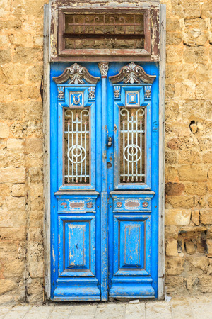 Ancient blue door in mediterranean city
