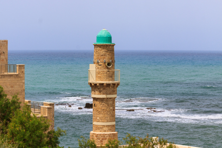 Minaret on sea background in Jaffo city photo