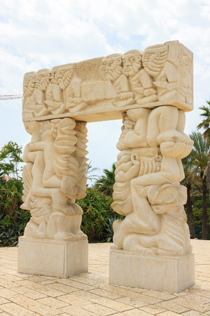 White stone arch in park Jaffa city photo