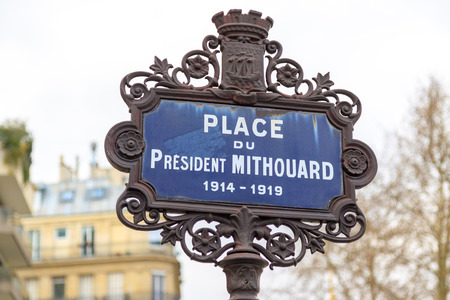 Traditional plaque Place du President Mithouard, Paris photo