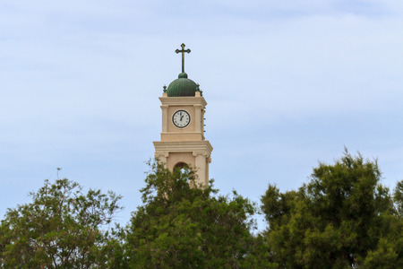 Cross and clock on belltower of the saint Peter monastery in Jaffa photo