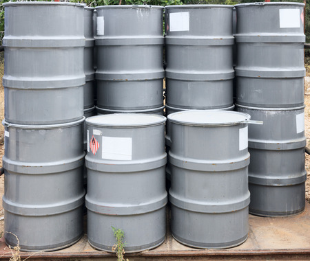 Gray barrels on a chemical plant photo
