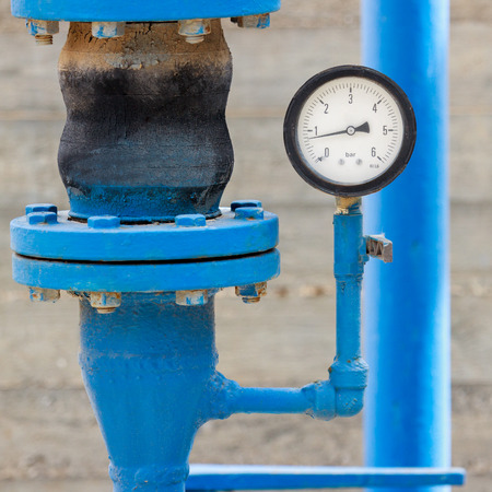 Manometer with blue pipe on chemical plant photo