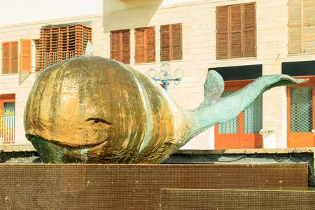 Statue of Jonah whale in Jaffa, Israel photo