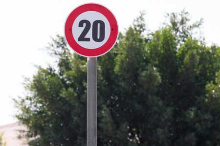 kilometer: The road sign 20 kilometer per hour Stock Photo