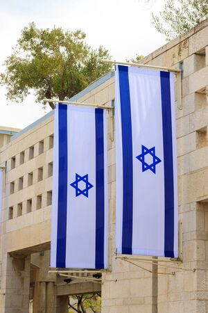 Two flags of Israel on a wall photo