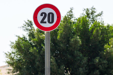 kilometer: The road sign speed limit 20 kilometer per hour Stock Photo
