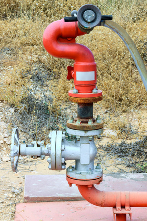 Bright red colored fire pipe on chemical plant photo