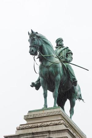 Bronze statue of Garibaldi on horse in Milan under rain on white background photo