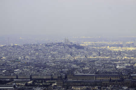 Panorama from Montparnasse tower to Louvre, Tuileries and Basilica Sacre Coeur, Paris  in morning fog photo