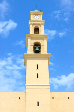 View from street to bell tower of monastery saint Peter in Jaffa photo