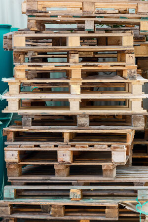 euro pallet: Wooden pallets near a wall Stock Photo
