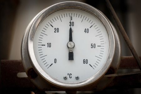 Round  infustrial thermometer on chemical plant photo