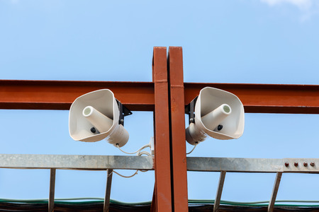 public address: White loudspeakers on the brown metal construction