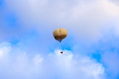 Big white military balloon on a blue sky photo