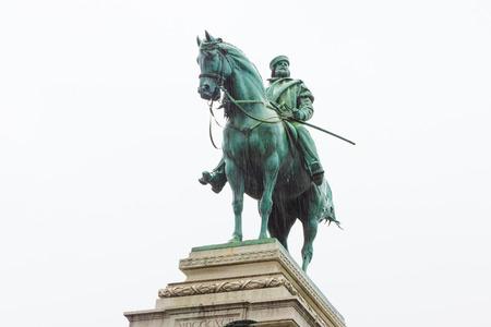 Old bronze statue of Garibaldi on horse in Milan under rain isolated on white background photo