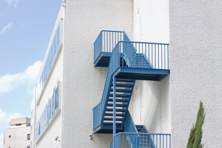 Blue staircase over the white wall photo