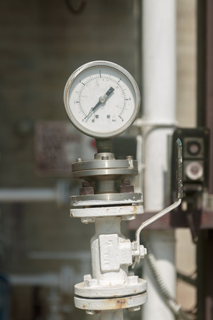 Old  industrial manometer on chemical plant photo