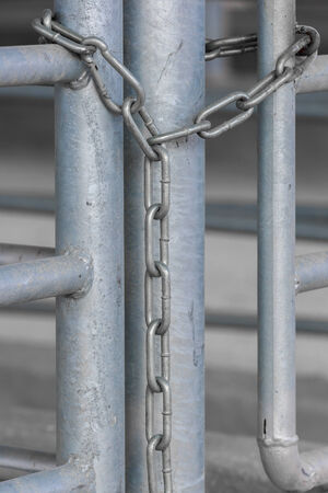 withhold: Metal chain on steel gates