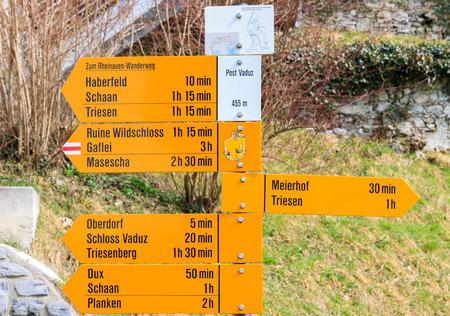 Big signpost on the main pedestrian street in Vaduz, capital of Liechtenstein photo