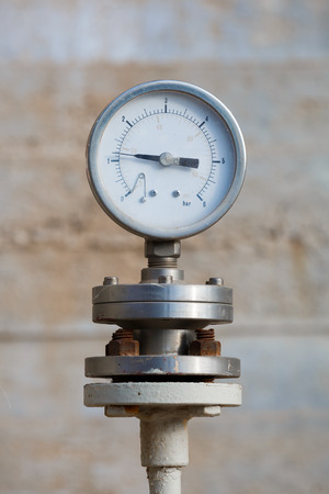 Old manometer on chemical plant photo