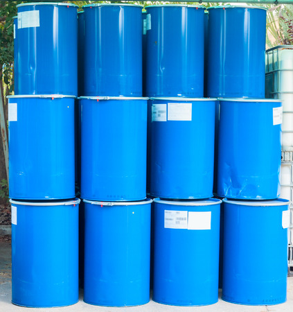 Some blue barrels on a chemical plant photo