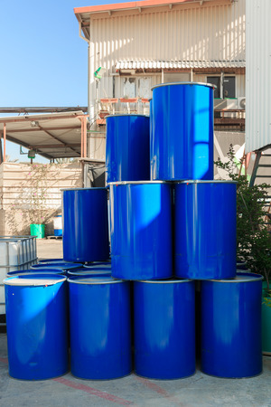 Pyramid of blue barrels on a chemical plant photo