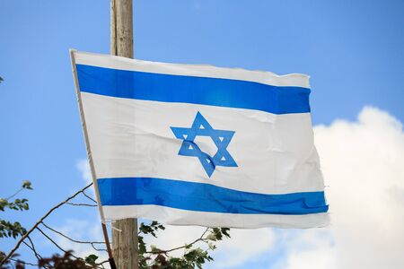 zionism: White and blue flag of Israel waving in the wind