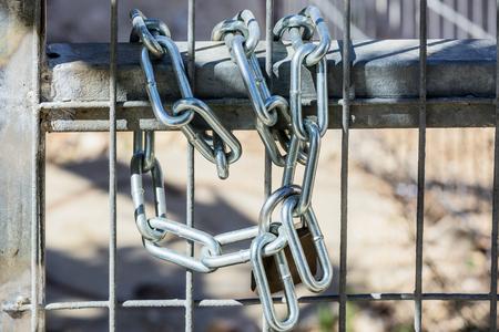 grates: Metal chain on steel grates