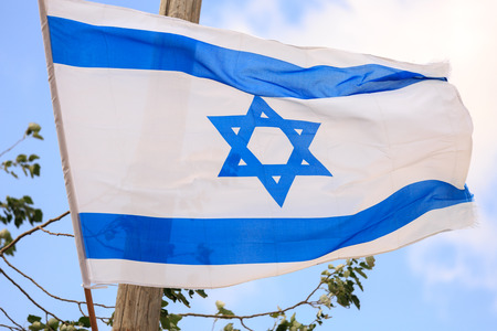 zionism: Big flag of Israel waving in the wind Stock Photo