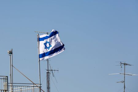 zionism: Flag of Israel waving in the sky in Jerusalem