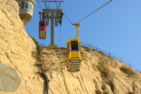 hanikra: Cableway with two, yellow and red, cabins in Rosh Hanikra Israel