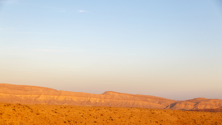 red mountain open space: Magestic landscape at the bottom of the Big Crater HaMakhtesh HaGadol in Israel Stock Photo