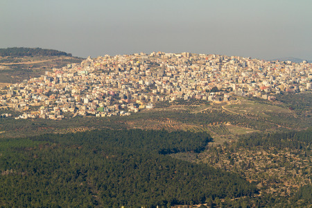 transfiguration: Arab village at the foot of Mount Tabor in northern Israel