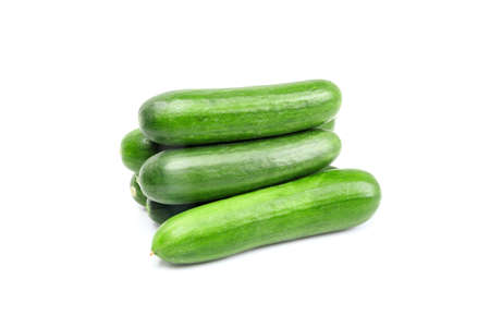 smal: Smal group of green cucumbers isolated on white background Stock Photo