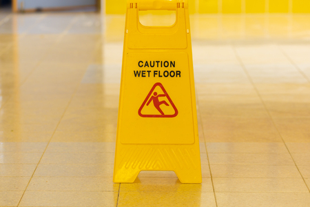 The wet floor yellow caution sign