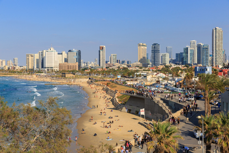 TEL AVIV ISRAEL - SEPTEMBER 17, 2015: People relax on a beach of Tel Aviv near Jaffa at december Editorial