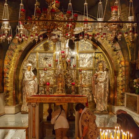 Jerusalem, Israel - Nov 06, 2016: Group of pilgrims at Mount Calvary, on altar in Temple of the Holy Sepulchre, Jerusalem, Israel Editorial