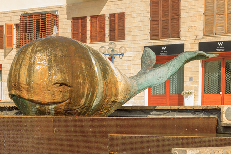 JAFFA  ISRAEL - APRIL 20, 2014: Statue of Jonah whale in Jaffa City Редакционное