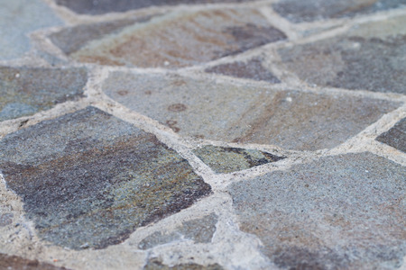 flagstone: A Flagstone Patio shot at an angle fading into a blurred background. Stock Photo