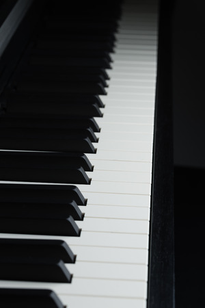 dramatically: A dramatically dark picture of a piano Stock Photo